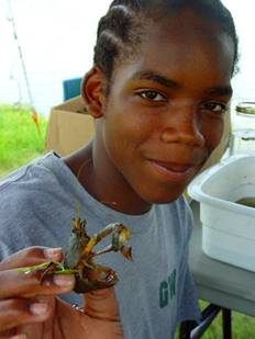 High school student at Gainesville Wilderness Institute with a crawfish collected from local waters.